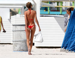 http://img298.imagevenue.com/loc549/th_260076655_lauren_stoner_bikini_topless_march19_2012_6_123_549lo.jpg