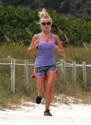 Julianne Hough jogging in tiny shorts on the beach in Miami, 10/06/11 (x11)